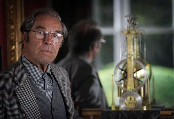 RAMSEY, UNITED KINGDOM - SEPTEMBER 17: World reknowned Watchmaker George Daniels photographed in his home next to the Breget Clock that he made. 17 September 2005, Ramsey, Isle of Man. (Photo by Christopher Furlong/Getty Images) *** Local Caption *** George Daniels